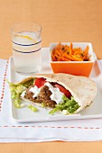 Falafel sandwich with lemon water and carrot salad