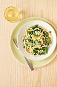 Fusilli pasta with asparagus, mange tout and peas