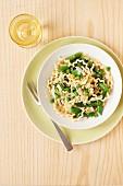 Fusilli pasta with asparagus, mange tout and peas