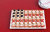 Berry fruit tarts arranged as an American flag for 4th July
