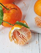 Tangerines, whole and half peeled