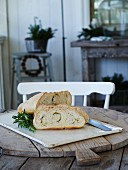 Yeast bread with rosemary on a rustic wooden table