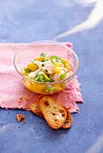 Ceviche scampi and peach