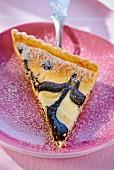 A slice of sesame seed cheesecake