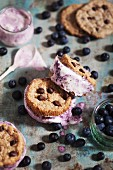 Ice cream cookie sandwiches with chocolate chips and blueberry ice cream
