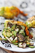 Stuffed courgette flowers with aubergines, courgette and feta cheese