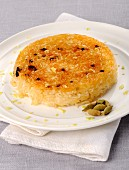 Caramelised rice cake with cardamom