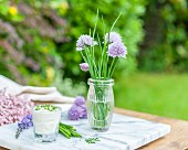 Chives and chive quark on a garden table