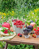 An arrangement of fruit on a garden table