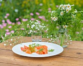 Dill and smoked salmon on a garden table