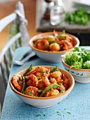 Potato and tomato stew with king prawns