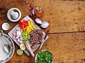 Beef steak with sliced vegetables and rocket