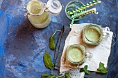 Green smoothies made with bananas, yoghurt and spinach
