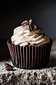 A coffee cupcake with coffee beans (close-up)