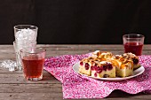 Slices of apricot cake and sour cherry cake with fruit juice