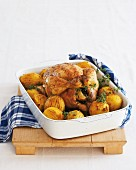 Roast chicken with rosemary, thyme and cumin potatoes