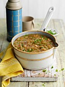 Caramelised onion soup in a saucepan