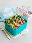 Caesar salad with chicken in lunch box