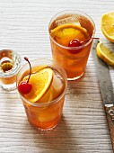Old Fashioned Bourbon cocktails with ice cubes