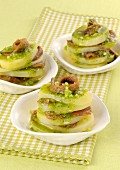 Potato mille feuilles with anchovies and herb sauce
