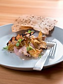 Smoked duck breast with crispy skin and caraway bread