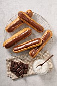 Chocolate eclairs and grated coconut