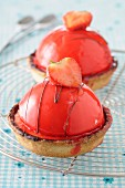 Strawberry dome tartlets on a wire rack