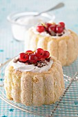 Charlottes with cream and redcurrants