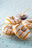 Doughnuts with icing and caramel stripes