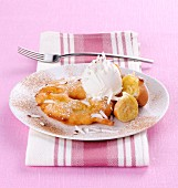Pineapple and banana cakes with coconut ice cream