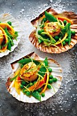 Scallops and a pea and papaya salad with tarragon