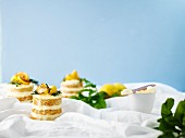 Lemon and olive oil layered cakes with cream cheese frosting and rosemary