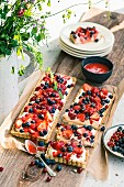 Berry tarts with mascarpone cream and fruit purée