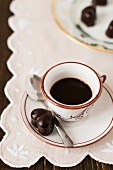 Coffee and heart-shaped chocolate pralines