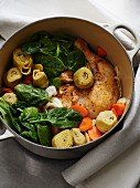Chicken stew with artichokes, spinach and carrots