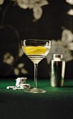 Vesper Martini made with gin, vodka and Kina Lillet on a casino table