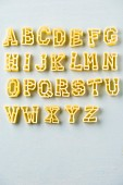 Alphabet pasta on a white surface