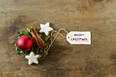 Christmas decorations with cinnamon sticks, cinnamon stars and a Christmas bauble