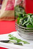 Fresh rocket salad in a glass bowl