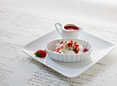 Greek yoghurt with pistachio nuts and strawberry sauce