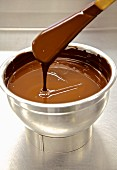 Tempered chocolate in a stainless steel bowl