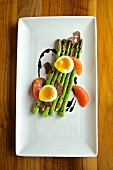 Green asparagus with soft boiled egg, blood oranges, truffles and balsamic vinegar