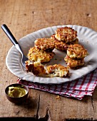 Cabbage fritters with bacon and mustard