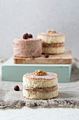 Sponge cakes with a cream filling, walnuts and hazelnuts