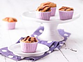Plum muffins with sesame seeds