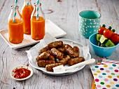 Beef chipolatas, vegetable kebabs and drinks