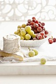 Frozen grapes and cheese board