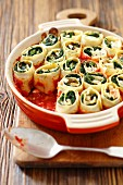Pasta rolls with spinach and feta cheese in tomato sauce