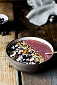 A smoothie bowl with quinoa and blueberries