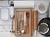 Kitchen utensils for making an ice cream dessert with berries